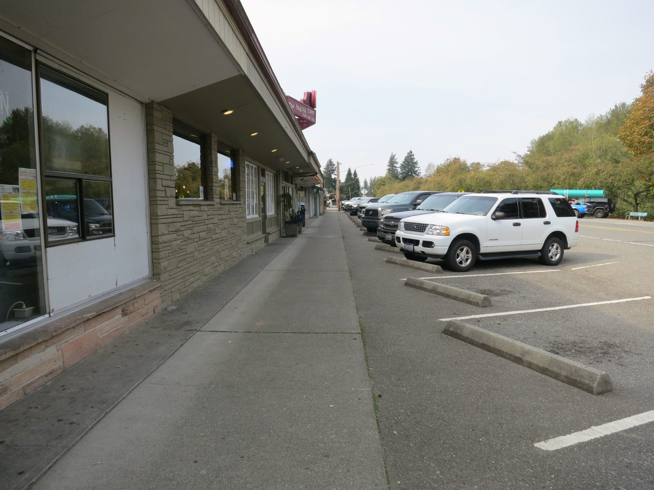 Image of the sidewalk along the south side of SR 202 in central Fall City.